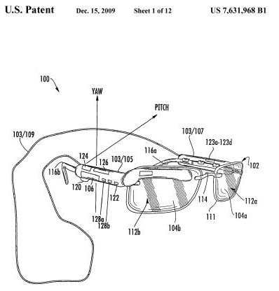 A screenshot from patent 7,631,968 B1 showing a display device clipped on to a pair of glasses.