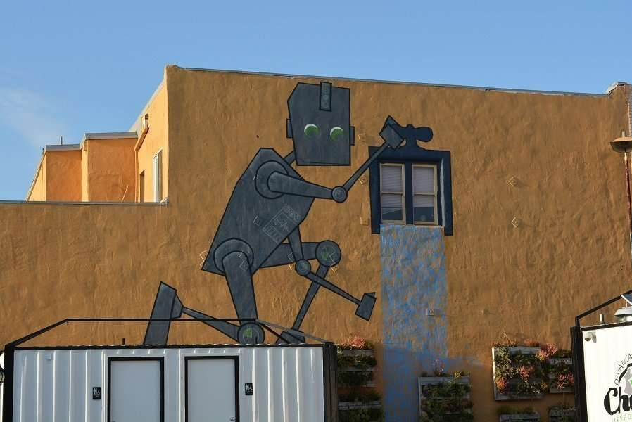 I love how this robot fits into the side of the building.