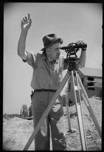 A Surveyor measuring land.