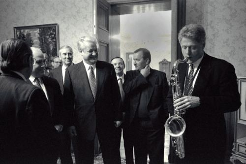 Bill Clinton playing a saxophone at a state sponsored event.
