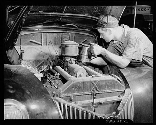 A mechanic working on a car (or auto).