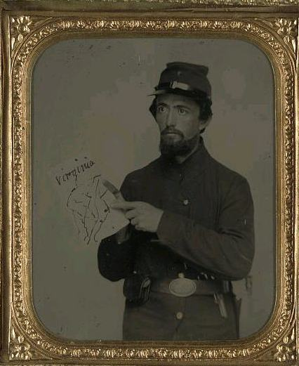 A Union soldier pointing out a location on a map of Virginia.