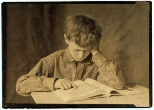 An image of a boy reading