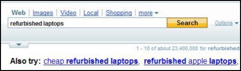 A Yahoo search box with a search for refurbished laptops and search query suggestions shown above the search results