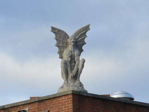 A statue on top of a building in Culpeper, Virginia. At least, I hope it was a statue.