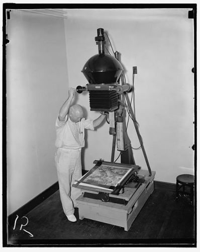 An Agricultural Adjustment Administration worker making prints for a $3,000,000 map in 1937.
