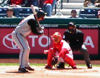 Batter at the Plate, with Toyota ad on the wall behind batter and catcher