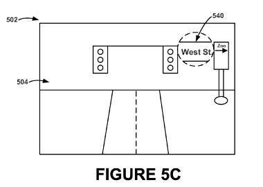 A screenshot from the patent application showing part of a street sign zoomed in upon after a triggering gesture.