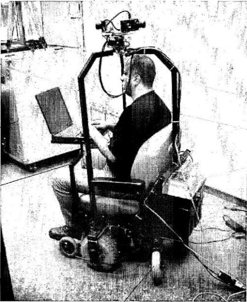 An image of someone riding a mobile camera device with cameras mounted on top and a laptop in front.